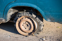 Broken overheated car tire Royalty Free Stock Photos