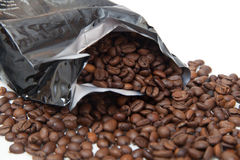 The broken package with coffee beans Stock Photography