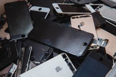 Broken panels and screens of iPhone phones stock images