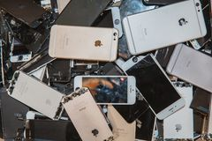 Broken panels and screens of iPhone phones. TOMSK, RUSSIA - November 29, 2017: broken panels and screens of iPhone phones lie in the service and are preparing royalty free stock photography