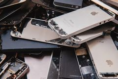 Broken panels and screens of iPhone. TOMSK, RUSSIA - November 29, 2017: broken panels and screens of iPhone phones lie in the service and are preparing for royalty free stock images