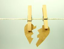 Broken paper heart Stock Photos