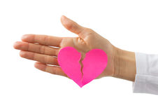 Broken paper heart on hand Royalty Free Stock Photos