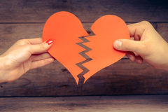 Broken paper heart Stock Image