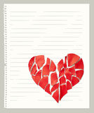 Broken paper heart on notebook page. With empty space for text royalty free stock photo