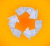 Broken paper recycle symbol on orange background. Stock Photo