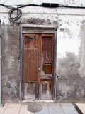 Broken patched old brown door in an abandoned house Stock Photo