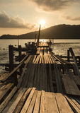 A Broken Path. A dilapidated makeshift wooden bridge use by traditional fisherman at Bayan Baru, Penang, Malaysia. Picture taken during sunrise Royalty Free Stock Photo