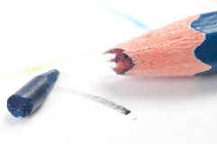 A broken pencil. On white paper Stock Photography