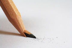 Broken Pencil. Macro of the tip of a broken pencil resting on a clean piece of white paper stock images