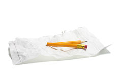 Broken Pencil and Crumpled Paper Royalty Free Stock Image