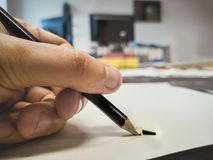 Broken pencil hand office background left-handed Stock Images