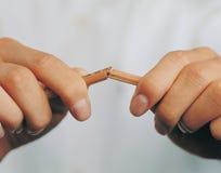 A broken pencil in a man's hands Stock Image