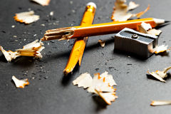 Broken pencil with metal sharpener and shavings. Royalty Free Stock Photos