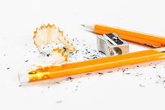 Broken pencil with metal sharpener and shavings. Stock Photography