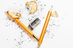 Broken pencil with metal sharpener and shavings. Stock Photos