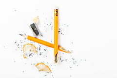 Broken pencil with metal sharpener and shavings. Royalty Free Stock Images