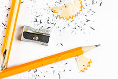 Broken pencil with metal sharpener and shavings. Royalty Free Stock Photography