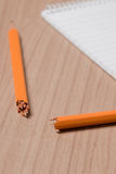 Broken pencil and notepad Royalty Free Stock Images