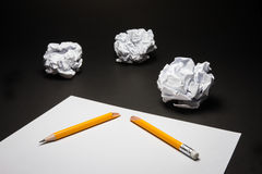 Broken pencil, paper, crumpled paper on black background.  Stock Photo