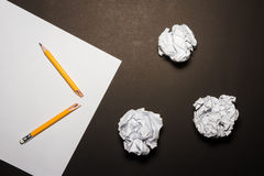 Broken pencil, paper, crumpled paper on black background. Royalty Free Stock Images