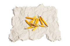 Broken Pencil Pieces and Waste Paper Stock Photo