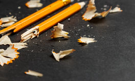 Broken pencil with shavings. Royalty Free Stock Image