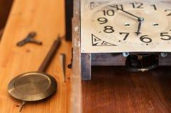 Antique pendulum clock. A broken pendulum clock to restore Royalty Free Stock Photos