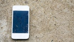 Broken Phone On The Concrete Floor Stock Photo