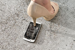 Broken phone screen from crushing by high heel shoe Royalty Free Stock Photography