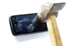 Broken phone screen and hammer Stock Photo
