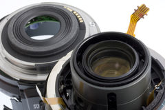 Broken photography lens. Broken autofocus 60mm lens - two parts with visible eletronic circuits Royalty Free Stock Photography