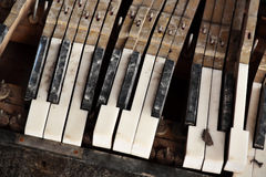 Broken piano keys. Photo of broken piano keys stock photo
