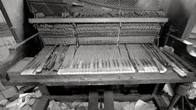 Broken Piano In Trashed Room. Trashed room in an old abandoned house Stock Photos