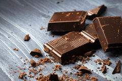 Broken pieces of chocolate Stock Images