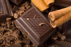 Broken pieces of chocolate and cinnamon Stock Images