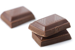 Broken pieces of chocolate isolated Stock Image