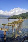 Broken pier in a sea inlet Stock Photos
