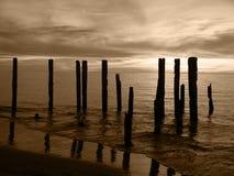 Broken Pier Sepia. Broken Pier silhouette Stock Photography