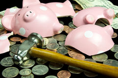 Broken Piggy Bank. With cash & coins Royalty Free Stock Image