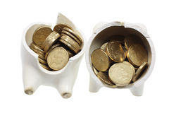 Broken Piggy Bank and Coins Royalty Free Stock Image