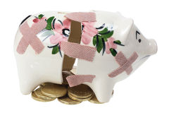Broken Piggy Bank and Coins Stock Photo