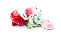 Broken piggy bank with coins Royalty Free Stock Image