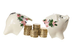 Broken Piggy Bank with Coins Stock Images