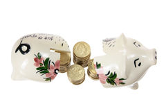 Broken Piggy Bank and Coins Stock Photos