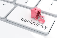 Broken piggy bank on the computer keyboard. Empty broken piggy bank on the computer keyboard. Crisis concept Stock Image