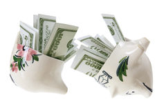 Broken Piggy Bank with Dollar Notes Stock Image