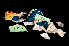 Broken piggy bank with iou's Stock Photos