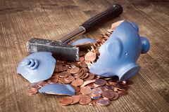 Broken piggy bank loaded with coins Royalty Free Stock Photography