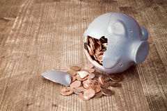 Broken piggy bank with and money Stock Images